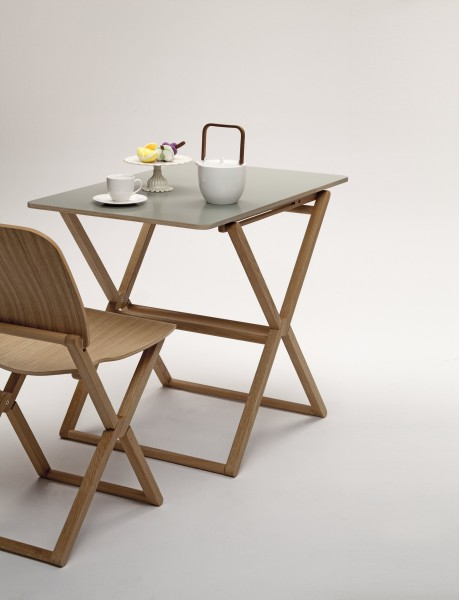 Treee bar is a wooden foldable table for two person designed by Luciano Bertoncini